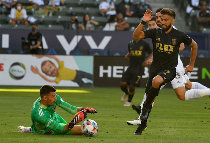 Galaxy goalie Jonathan Bond stops a shot by LAFC's Diego Rossi in the first half May 8, 2021.