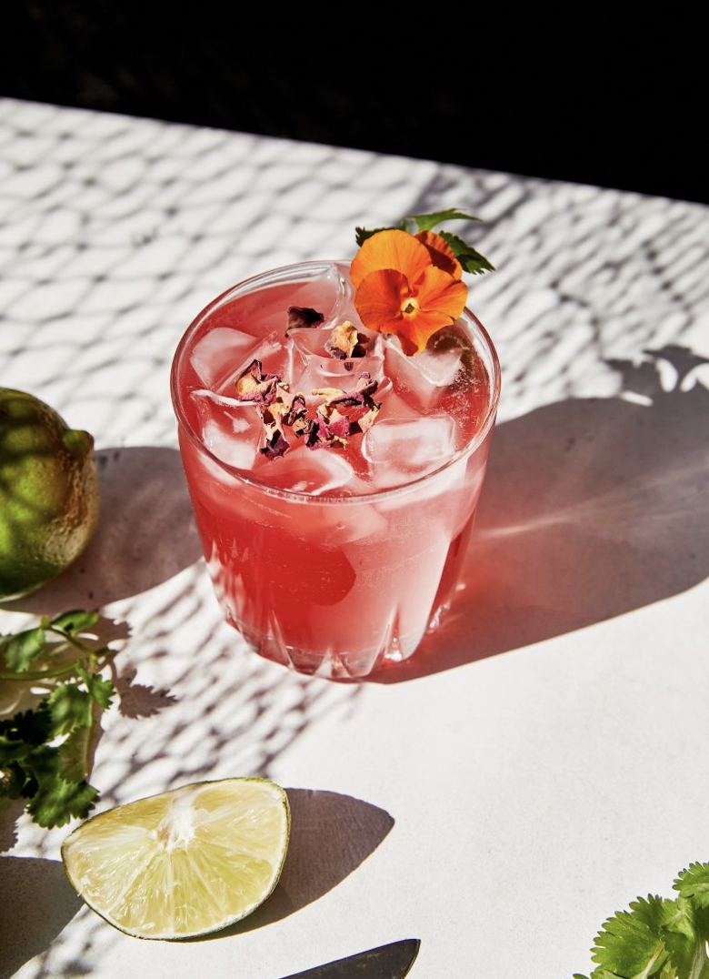 """<p>While we love a traditional basil smash, this tequila-and-hibiscus version makes a worthwhile twist for summer days by the pool. Cilantro and hibiscus are an excellent complement to the Reposado tequila used here. Don't forget to double-strain the cocktail for extra smoothness.</p><p><strong>Ingredients:</strong><br><br> 1 ounce hibiscus tea</p><p>2 ounces <a href=""""https://www.santospirit.com/home/"""" rel=""""nofollow noopener"""" target=""""_blank"""" data-ylk=""""slk:Santo Reposado tequila"""" class=""""link rapid-noclick-resp"""">Santo Reposado tequila</a><br></p><p>1/2 ounce agave syrup</p><p>3/4 ounce lime juice</p><p>1/4 cup fresh cilantro leaves with tender stems</p><p>Ice</p><p>Garnish: hibiscus leaves, lime wheel, edible flowers </p><p><strong>Directions:</strong></p><p>Brew hibiscus tea and let cool. In a cocktail shaker with ice add tequila, hibiscus tea, agave, lime juice, and fresh cilantro. Shake for 30 seconds. Double strain into a cocktail glass filled with ice and garnish.</p>"""