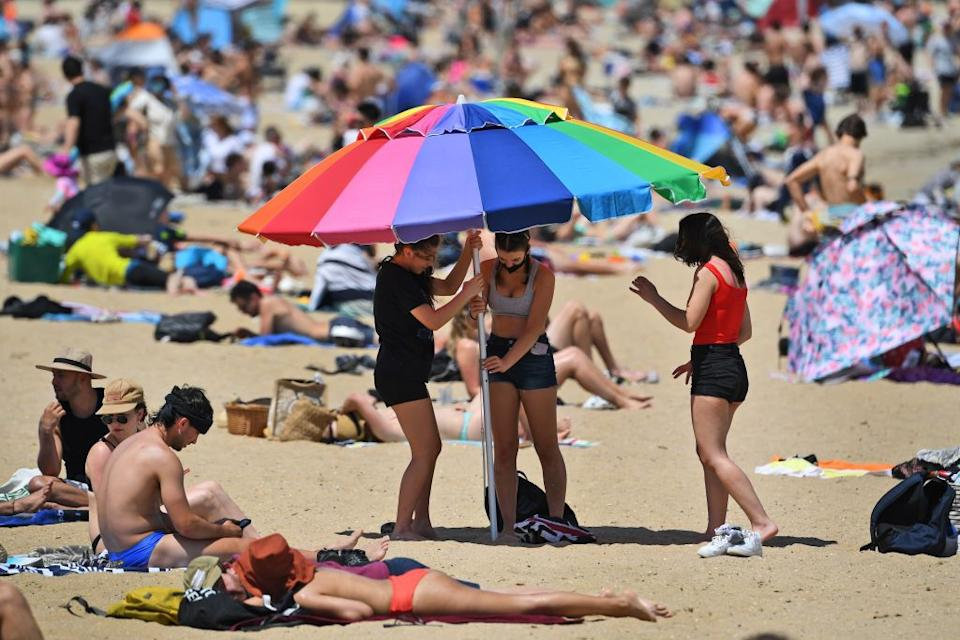 People enjoy the warm weather on Melbourne's St Kilda Beach.