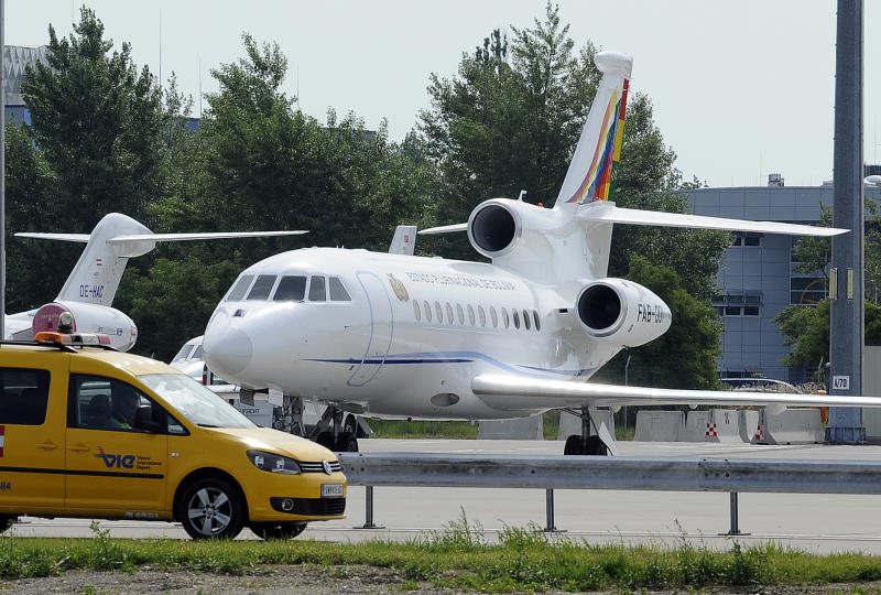 The plane of Bolivia's President Evo Morales is parked at Vienna's Schwechat airport, Wednesday, July 3, 2013. The plane was rerouted to Austria after various European countries refused to let it cross their airspace because of suspicions that NSA leaker Edward Snowden was on board, Bolivian officials said Tuesday. Officials in both Austria and Bolivia said that Snowden was not on the plane, which was taking Morales home from a summit in Russia, where he had suggested that his government would be willing to consider granting asylum to the American. (AP Photo/Hans Punz)