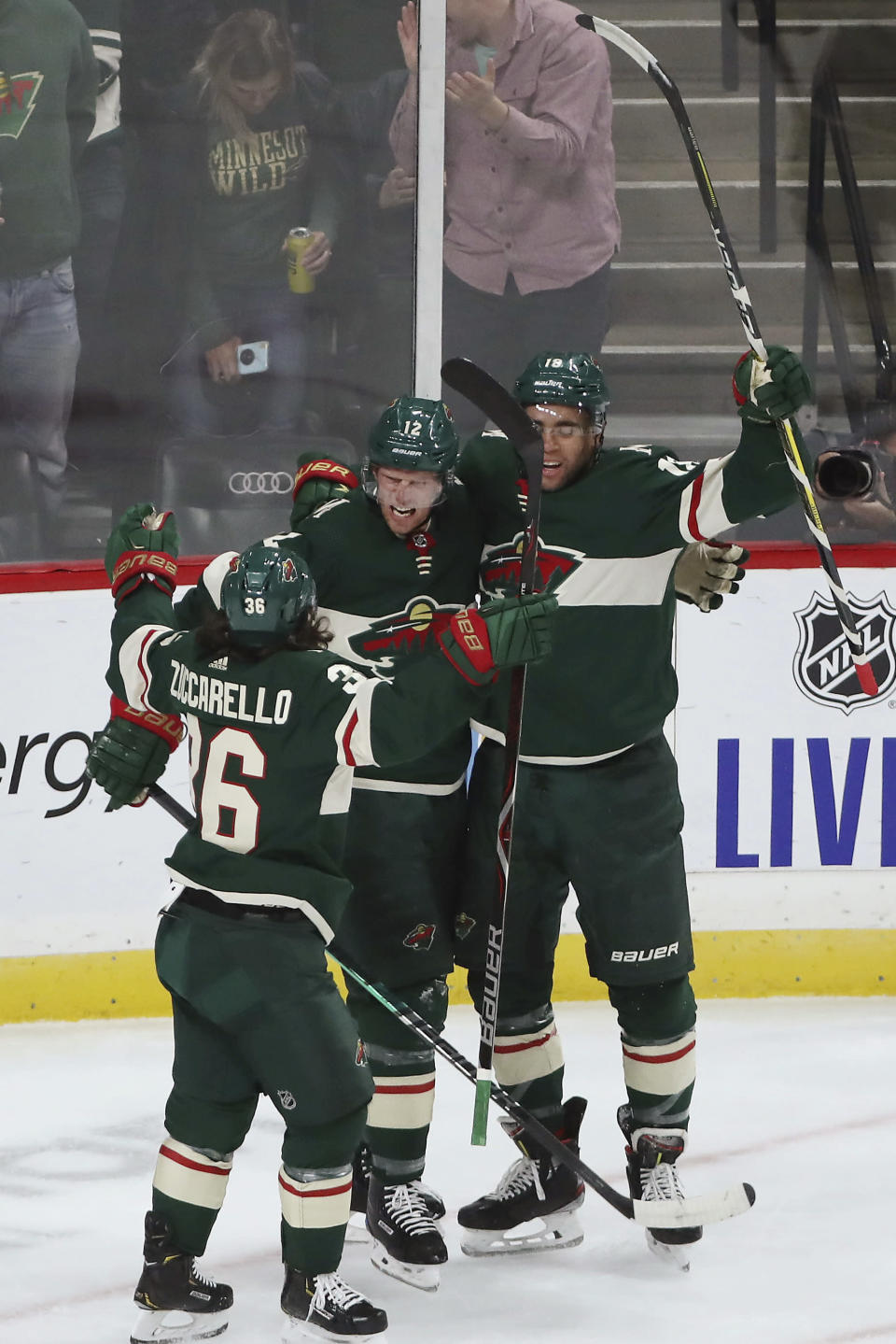 Minnesota Wild's Eric Staal, center, celebrates with Mats Zuccarello, left, and Jordan Greenway, right, after Staal scored a goal against Edmonton during the first period of an NHL hockey game Tuesday, Oct. 22, 2019, in St. Paul, Minn. (AP Photo/Stacy Bengs)