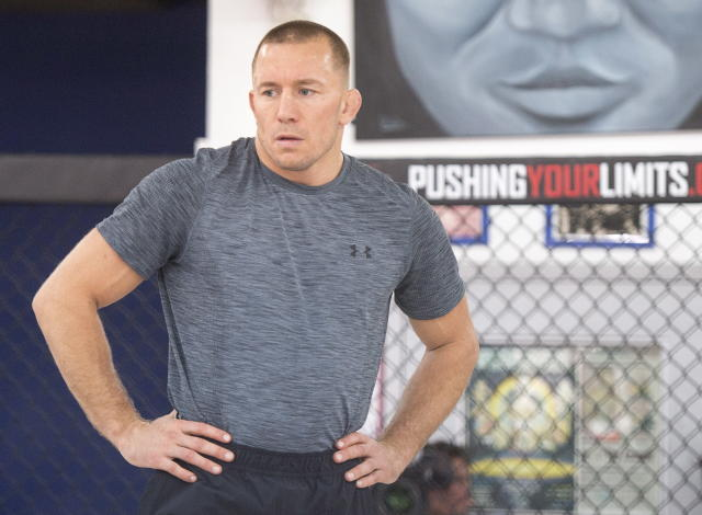 Georges St-Pierre will return to the Octagon for the first time in four years at UFC 217. (AP)