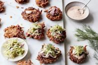 """The """"ultimate Jewish deli delight,"""" <a href=""""https://www.epicurious.com/recipes-menus/gail-simmons-latke-reubens-super-bowl-article?mbid=synd_yahoo_rss"""" rel=""""nofollow noopener"""" target=""""_blank"""" data-ylk=""""slk:from Top Chef judge Gail Simmons"""" class=""""link rapid-noclick-resp"""">from <em>Top Chef</em> judge Gail Simmons</a>, just so happens to be something you can eat with one hand (which frees the other up to hold a beer). <a href=""""https://www.epicurious.com/recipes/food/views/latke-reubens?mbid=synd_yahoo_rss"""" rel=""""nofollow noopener"""" target=""""_blank"""" data-ylk=""""slk:See recipe."""" class=""""link rapid-noclick-resp"""">See recipe.</a>"""