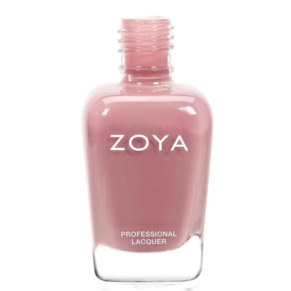 """<p><strong>Zoya</strong></p><p>walmart.com</p><p><strong>$9.25</strong></p><p><a href=""""https://go.redirectingat.com?id=74968X1596630&url=https%3A%2F%2Fwww.walmart.com%2Fip%2F554301031&sref=https%3A%2F%2Fwww.harpersbazaar.com%2Fbeauty%2Fnails%2Fg33660165%2Fnail-colors-for-dark-skin%2F"""" rel=""""nofollow noopener"""" target=""""_blank"""" data-ylk=""""slk:Shop Now"""" class=""""link rapid-noclick-resp"""">Shop Now</a></p><p>This rosy beige brings out the warmer undertones in medium to deep skin. It's subtle but gorgeous, and will be your new go-to nude mani shade.</p>"""