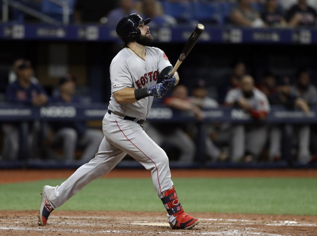 Boston Red Sox's Mitch Moreland watches his solo home run off Tampa Bay Rays relief pitcher Diego Castillo during the 11th inning of a baseball game, Saturday, Sept. 21, 2019, in St. Petersburg, Fla. (AP Photo/Chris O'Meara)