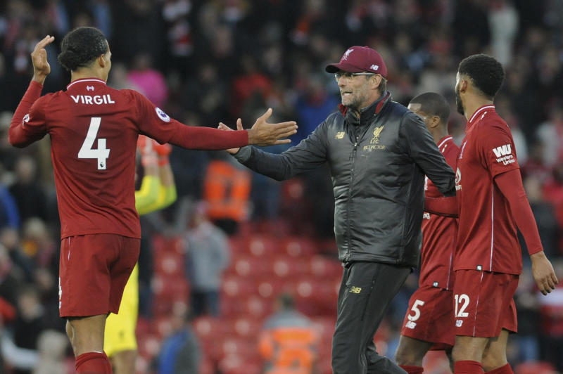 Liverpool manager Juergen Klopp congratulates Liverpool's Virgil van Dijk, left after the English Premier League soccer match between Liverpool and Manchester City at Anfield stadium in Liverpool England Sunday Oct. 7 2018. (AP