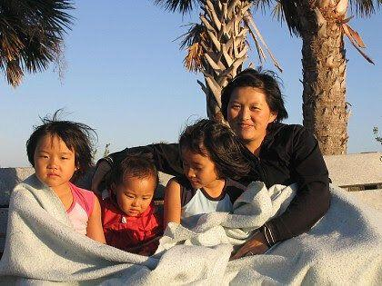 Nadya Okamoto, her two younger sisters and mother, pose on the beach for a photo. (Credit: Nadya Okamoto)