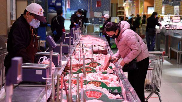 PHOTO: A consumer selects meat at a supermarket in Handan, north China's Hebei Province, April 10, 2020. (Hao Qunying/Xinhua via Newscom)