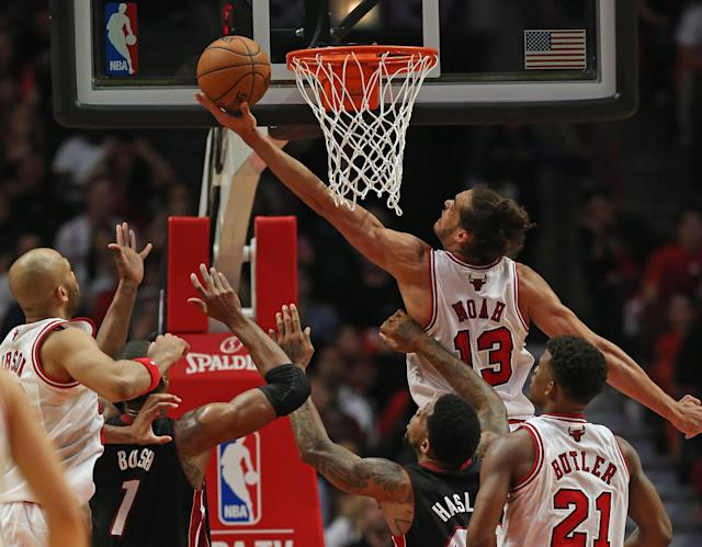 CHICAGO, IL - MAY 10: Joakim Noah #13 of the Chicago Bulls puts up a shot over Chris Bosh #1 and Udonis Haslem #40 of the Miami Heat in Game Three of the Eastern Conference Semifinals during the 2013 NBA Playoffs at the United Center on May 10, 2013 in Chicago, Illinois. NOTE TO USER: User expressly acknowledges and agrees that, by downloading and or using this photograph, User is consenting to the terms and conditions of the Getty Images License Agreement. (Photo by Jonathan Daniel/Getty Images)