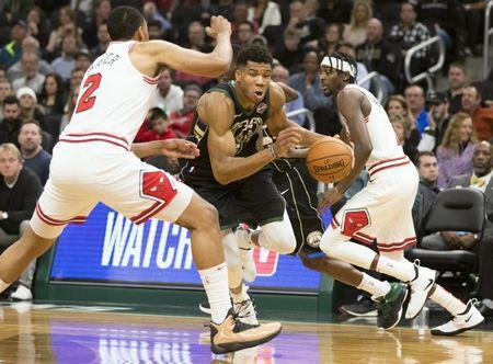 Nov 16, 2018; Milwaukee, WI, USA; Giannis Antetokounmpo (34) drives for the basket against Chicago Bulls forward Jabari Parker (2) during the fourth quarter at Wisconsin Entertainment and Sports Center. Jeff Hanisch-USA TODAY Sports