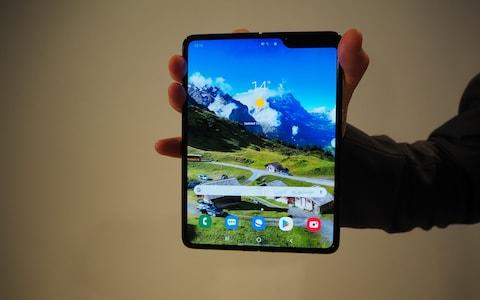The phone unfolds to reveal a tablet-sized internal screen