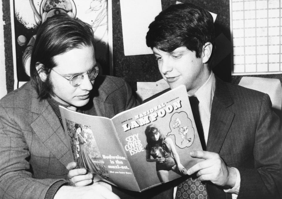 Robert Hoffman, managing editor, and Douglas C. Kenney, editor, look over the first copy of National Lampoon - a monthly humor magazine with each issue treating a separate topic with the satirical style of the famous university magazine it parodies.