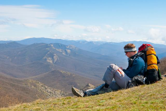 avenza maps app hiker using mobile device