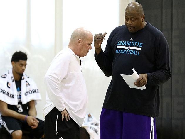 Steve Clifford and Patrick Ewing swap tall tales. (Getty Images)