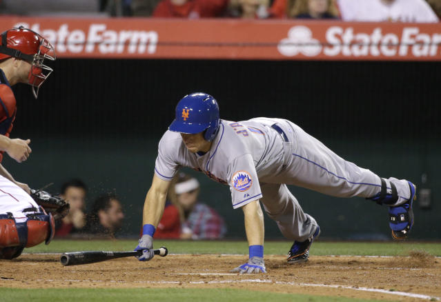 New York Mets' Travis d'Arnaud falls to the ground as he avoids a pitch while batting against the Los Angeles Angels during the fourth inning of a baseball game on Friday, April 11, 2014, in Anaheim, Calif. (AP Photo/Jae C. Hong)