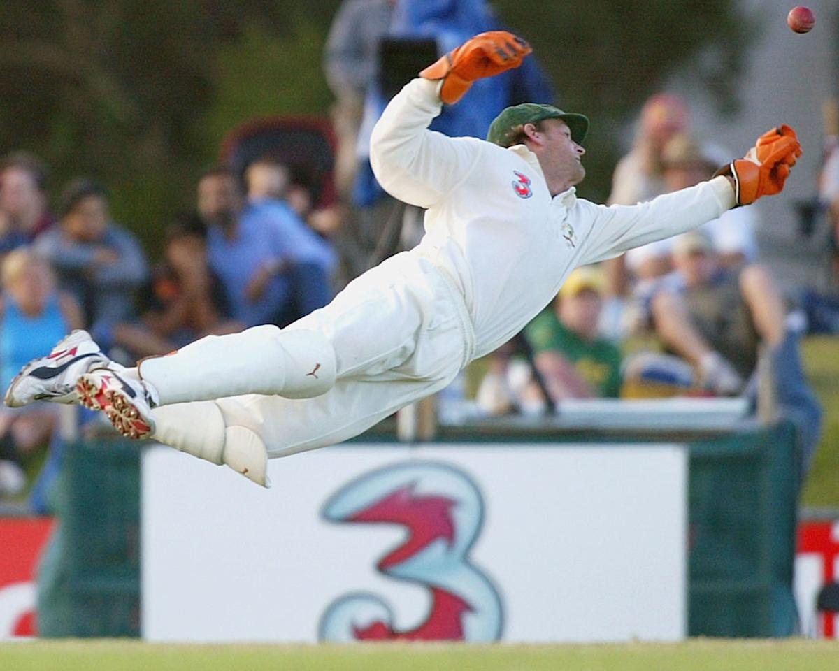 CAIRNS, AUSTRALIA - JULY 13:  Adam Gilchrist of Australia dives in vain after a catch from Upul Chandana of Sri Lanka during day five of the Second Test between Australia and Sri Lanka at Cazalys Stadium on July 13 2004 in Cairns, Australia. (Photo by Hamish Blair/Getty Images)