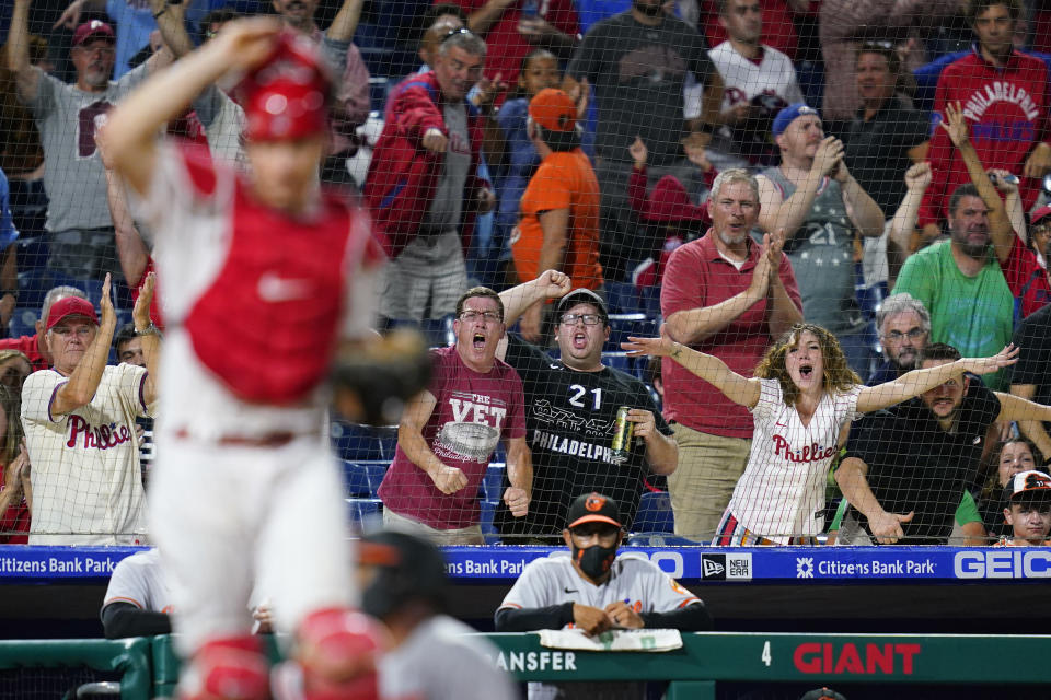 Fans react after Baltimore Orioles' Pedro Severino was tagged out at home by Philadelphia Phillies catcher J.T. Realmuto after trying to score on a single by Pat Valaika during the eighth inning of an interleague baseball game, Wednesday, Sept. 22, 2021, in Philadelphia. (AP Photo/Matt Slocum)