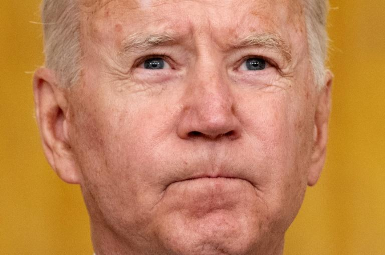 US President Joe Biden faces an outcry from Republicans and a hit in the polls (AFP/Jim WATSON)