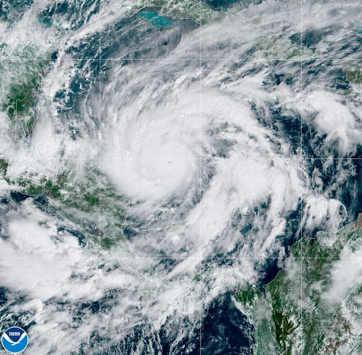 A satellite image taken Monday, Nov. 2, 2020, shows Hurricane Eta in the Caribbean Sea approaching the border of Honduras and Nicaragua. Eta quickly gained force Monday as it headed for Central America on the verge of becoming a major hurricane, threatening massive flooding and landslides across a vulnerable region.