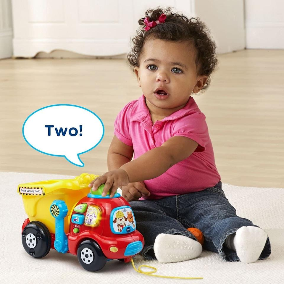 """Teach the kiddies counting by dropping colorful boulders in the back bucket while playing melodies and phrases for learning about tools and colors.<br /><br /><strong>Promising review:</strong>""""Super cute toy for the toddler age! Plus for all moms out there who go nuts when the same five songs go off this one actually has an off switch! Yay!<strong>It also has a low and medium sound setting which is a must for any toy I buy.</strong>The buttons and lever on the dump truck are great for little hands. Definitely worth every penny!"""" —<a href=""""https://amzn.to/3dFwaxO"""" target=""""_blank"""" rel=""""noopener noreferrer"""">Liesl</a><br /><strong><br />Get it from Amazon for<a href=""""https://amzn.to/3namDC9"""" target=""""_blank"""" rel=""""noopener noreferrer"""">$17.99+</a>(available in two colors).</strong>"""
