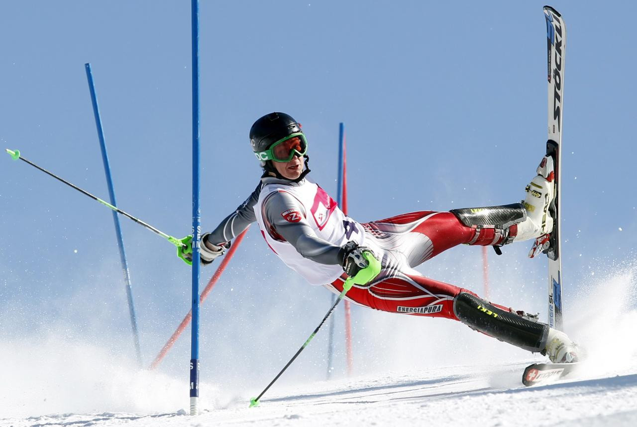 WORLD PRESS PHOTO CONTEST WINNERS. PICTURE 11 OF 19 Andrzej Grygiel, a Polish photographer working for PAP-Polska Agencja Prasowa won the 2nd Prize Sports Action Single category of the 2014 World Press Photo contest with this picture of a skier competing on the slalom modality in Szczyrk, taken March 24, 2013. The prize-winning entries of the World Press Photo Contest 2014, the world's largest annual press photography contest, were announced February 14, 2014. REUTERS/Andrzej Grygiel/World Press Photo Handout via Reuters (POLAND - Tags: MEDIA SOCIETY) NO COMMERCIAL OR BOOK SALES. NO SALES. NO ARCHIVES. FOR EDITORIAL USE ONLY. NOT FOR SALE FOR MARKETING OR ADVERTISING CAMPAIGNS. THIS IMAGE HAS BEEN SUPPLIED BY A THIRD PARTY. IT IS DISTRIBUTED, EXACTLY AS RECEIVED BY REUTERS, AS A SERVICE TO CLIENTS. MANDATORY CREDIT