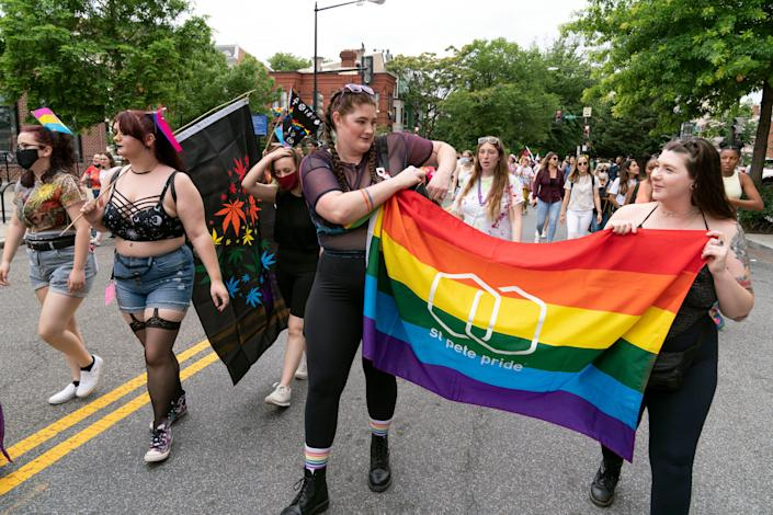 LGBTQ participants march in downtown to recognize the rich culture of Washington, Saturday, June 12, 2021, in Washington.