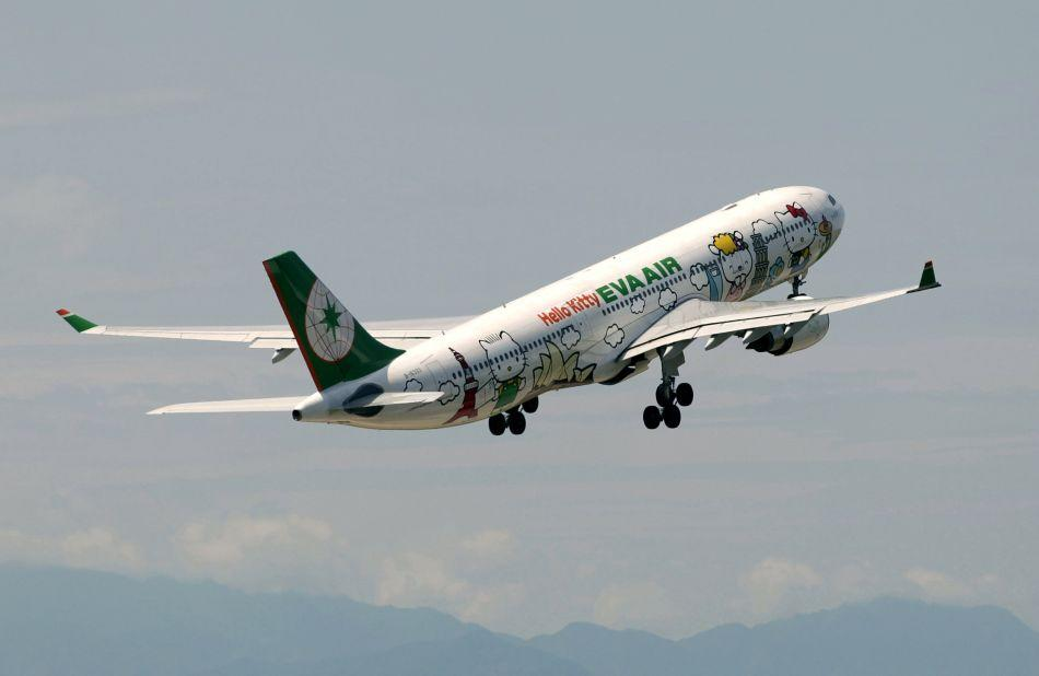 An aircraft of Taiwan's Eva Airlines, decorated with Hello Kitty motifs, takes off from Taoyuan International Airport, northern Taiwan to Sapporo, Japan