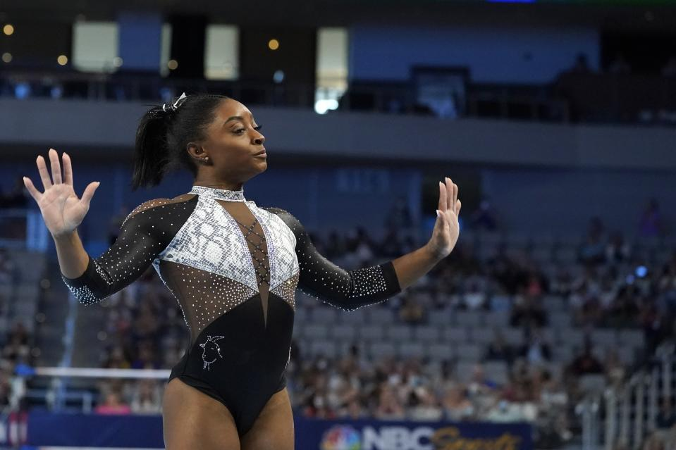 Simone Biles competes in the floor exercise during the U.S. Gymnastics Championships, Sunday, June 6, 2021, in Fort Worth, Texas. (AP Photo/Tony Gutierrez)