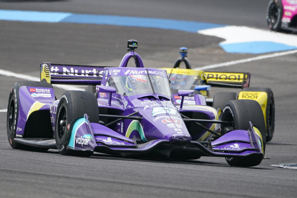 FILE - Romain Grosjean, of Switzerland, drives into the second turn during the IndyCar auto race at Indianapolis Motor Speedway in Indianapolis, Saturday, Aug. 14, 2021. Grosjean will move to Andretti Autosport next season and drive the full 17-race schedule, including the Indianapolis 500. The Frenchman has fallen in love with IndyCar since moving to the series this season from Formula One. (AP Photo/Michael Conroy, File)