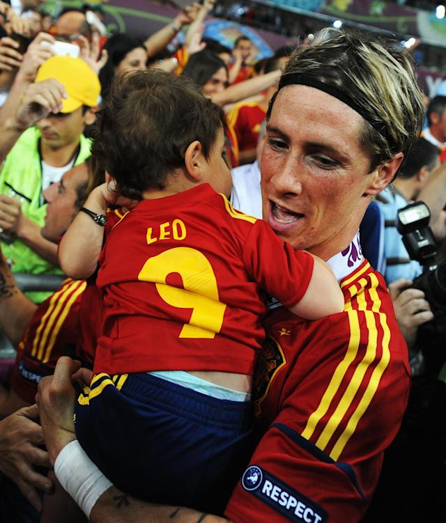 KIEV, UKRAINE - JULY 01: Fernando Torres of Spain holds his daughter Nora Torres (hidden) and son Leo Torres following victory in the UEFA EURO 2012 final match between Spain and Italy at the Olympic Stadium on July 1, 2012 in Kiev, Ukraine. (Photo by Jasper Juinen/Getty Images)