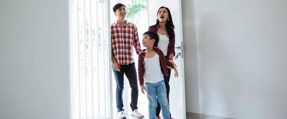 family asian entering their new home. buying new house concept