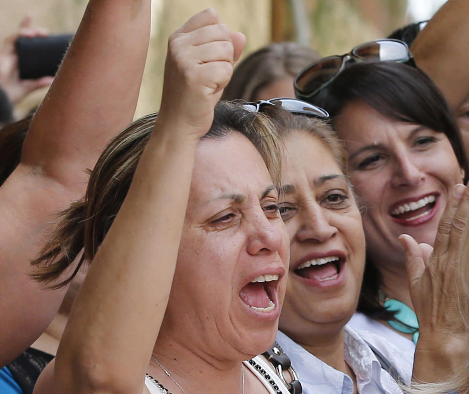 Virginia Aguiar reacts in Phoenix, Wednesday, May 8, 2013 to a guilty verdict in the trial of Jodi Arias, a waitress and aspiring photographer charged with killing her boyfriend, Travis Alexander, in Arizona in 2008. The four month trial included graphic details of their sexual escapades and photos of Alexander just after his death. (AP Photo/Matt York)