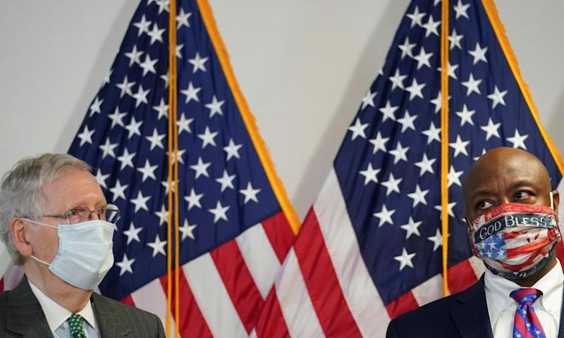 Mitch McConnell with fellow GOP senator Tim Scott, the author of a police reform bill described as 'woefully inadequate' by Democrats.