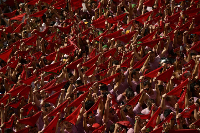 <p>Revelers hold up neckties during the launch of the <em>chupinazo</em> rocket to celebrate the official opening of the 2017 San Fermín Fiesta. (Photo: Alvaro Barrientos/AP) </p>