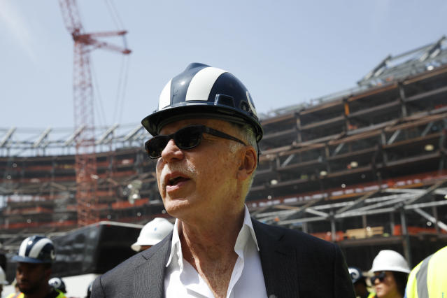Los Angeles Rams owner Stan Kroenke and players tour the team's new NFL football stadium Thursday, June 14, 2018, in Inglewood, Calif. Coach Sean McVay scrapped the final practice of minicamp and took his players and coaches on a tour of their multibillion-dollar stadium, which will open for the 2020 season. (AP Photo/Jae C. Hong)