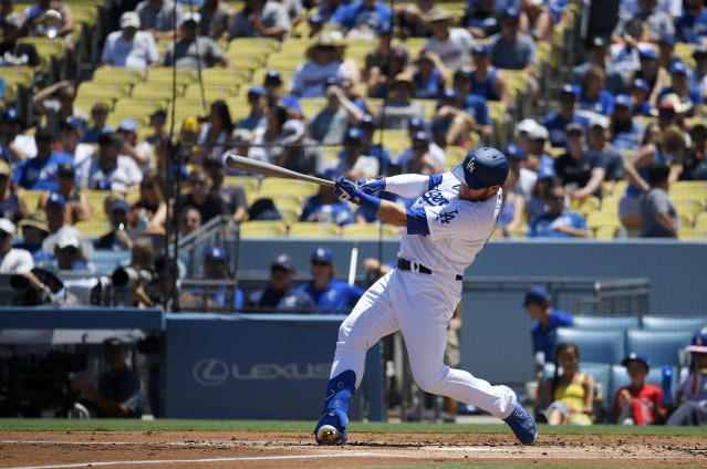 Los Angeles Dodgers' Max Muncy hits a solo home run during the second inning of a baseball game against the San Diego Padres, Sunday, Aug. 4, 2019, in Los Angeles. (AP Photo/Mark J. Terrill)