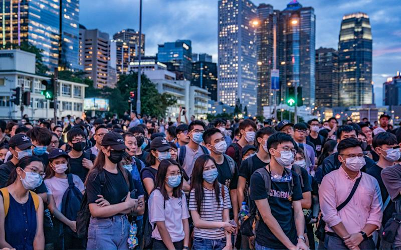 Protesters occupy a street demanding Hong Kong leader to step down after a rally against the now-suspended extradition bill  - Getty Images AsiaPac