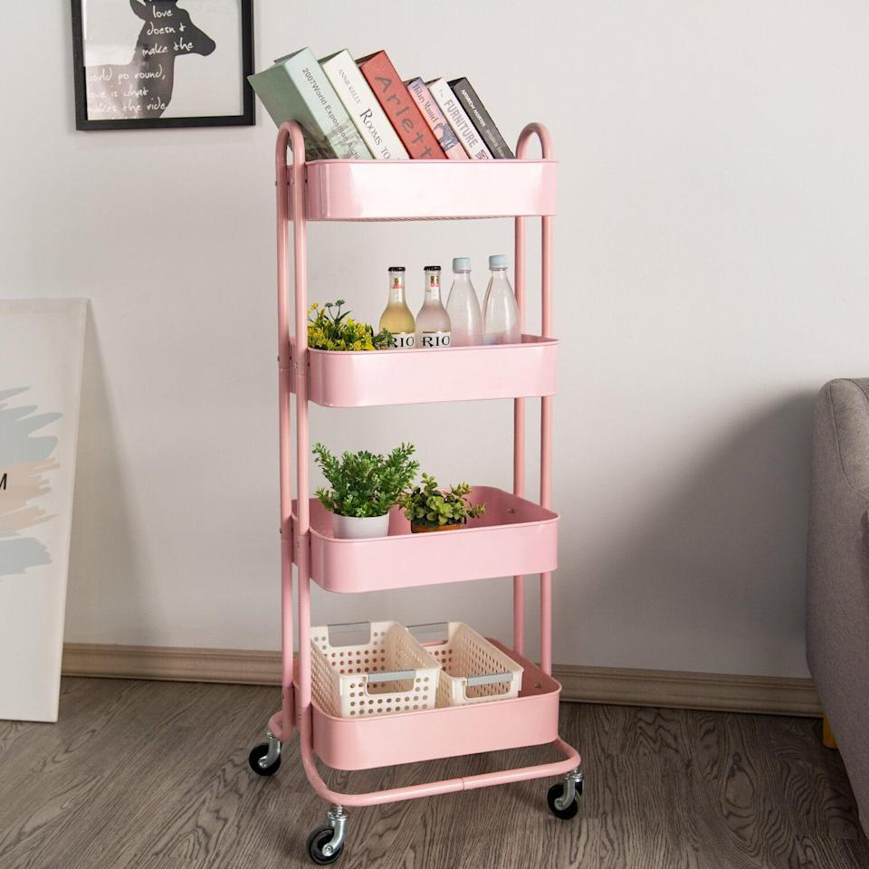 <p>They can store books, plants, decor, and other necessities on this cute <span>Metal Rolling Utility Cart</span> ($58, originally $66).</p>