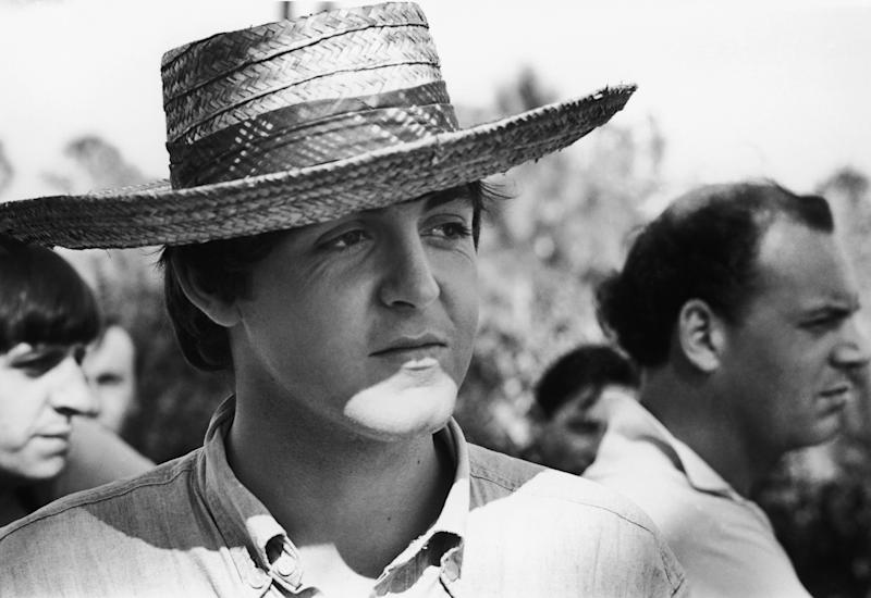Beatles singer and songwriter Paul McCartney wearing a straw hat while filming 'Help' in The Bahamas, 2nd March 1965.