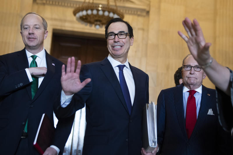UNITED STATES - MARCH 17: Treasury Secretary Steven Mnuchin asks the media for social distancing before delivering remarks on the coronavirus relief package after the Senate Republican Policy luncheon in Russell Building on Tuesday, March 17, 2020. Larry Kudlow, right, White House economic adviser, and Eric Ueland, legislative affairs director, also appear. (Photo By Tom Williams/CQ-Roll Call, Inc via Getty Images)