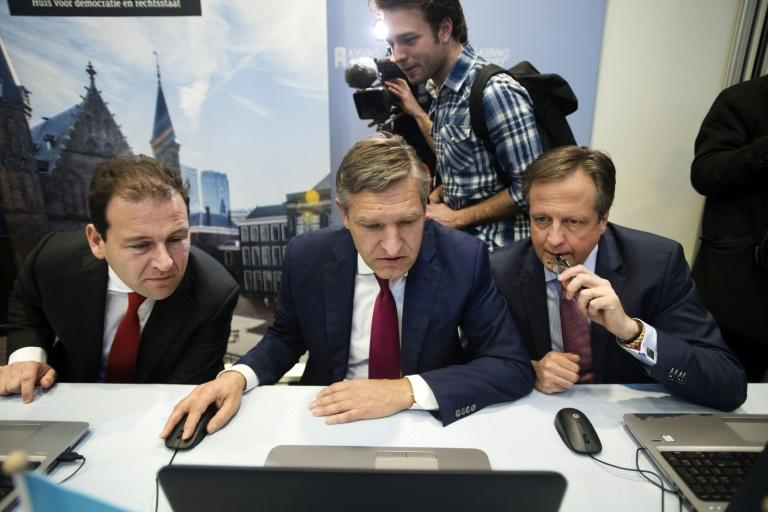 (From left) PvdA Party leader Lodewijk Asscher, CDA Party leader Sybrand Buma and D66 Party leader Alexander Pechtold file in the 'Stemwijzer', an online voting guide for the Dutch elections, on March 2, 2017 in the Hague