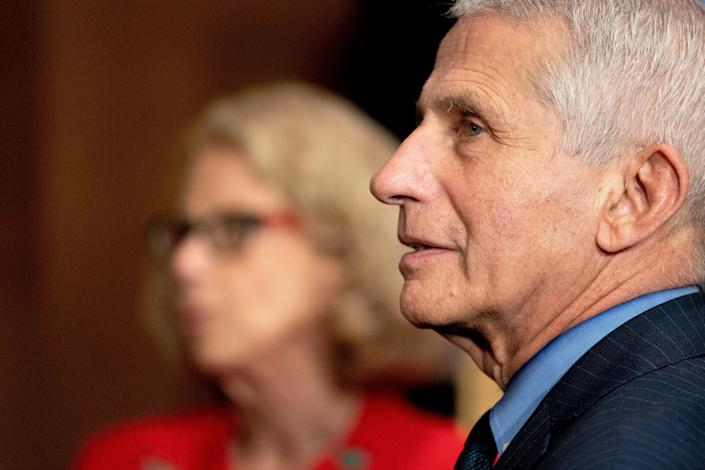 Dr. Anthony Fauci, Director of the National Institute of Allergy and Infectious Diseases, and Diana Bianchi, Director of the Eunice Kennedy Shriver National Institute of Child Health and Human Development, talk following a Senate Appropriations Subcommittee hearing May 26, 2021 on Capitol Hill in Washington, D.C. (Getty Images)