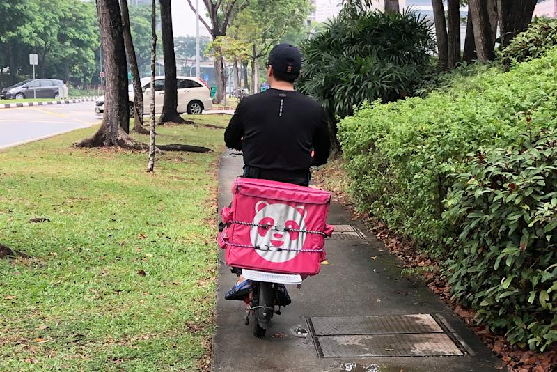 A Foodpanda delivery rider on an e-scooter seen along Jurong East Street 21 on 5 November 2019. (PHOTO: Dhany Osman / Yahoo News Singapore)