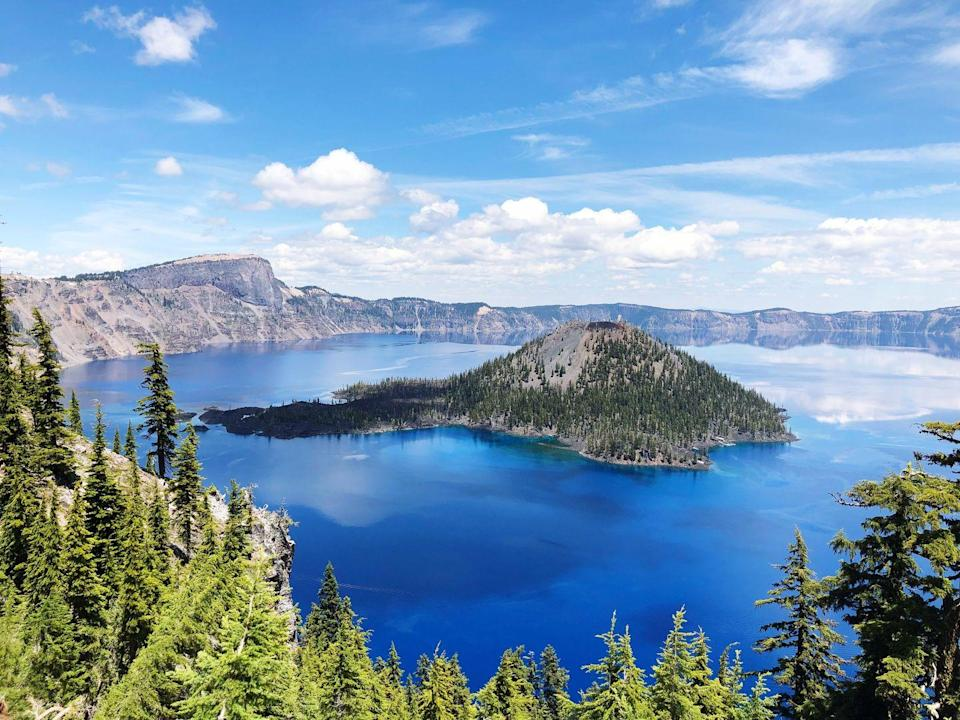 """<p><a href=""""https://www.nps.gov/crla/index.htm"""" rel=""""nofollow noopener"""" target=""""_blank"""" data-ylk=""""slk:Crater Lake National Park"""" class=""""link rapid-noclick-resp""""><strong>Crater Lake National Park </strong></a></p><p>Nature can be unpredictable, and that's on display here. A volcano erupted almost 8,000 years ago, and then caved in on itself. The result created this beautiful, deep lake that is filled by rain and snow. Its sparkling color is magnificent in the sun.</p>"""