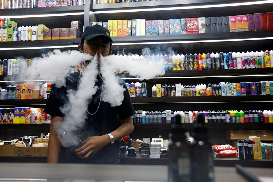 An employee at a vape shop in Jakarta, Indonesia. Photo: Ajeng Dinar Ulfiana/Reuters