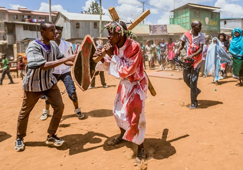 Christian devotees reenact the Way of the Cross, or Jesus Christ's passion, during a Good Friday commemoration in Kibera, Nairobi, on April 19, 2019. (BRIAN OTIENO via Getty Images)