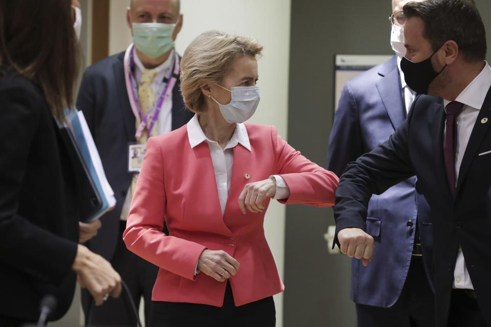 European Commission President Ursula von der Leyen, left, greets Luxembourg's Prime Minister Xavier Bettel with an elbow bump during a round table meeting at an EU summit in Brussels, Friday, July 17, 2020. Leaders from 27 European Union nations meet face-to-face on Friday for the first time since February, despite the dangers of the coronavirus pandemic, to assess an overall budget and recovery package spread over seven years estimated at some 1.75 trillion to 1.85 trillion euros. (Stephanie Lecocq, Pool Photo via AP)