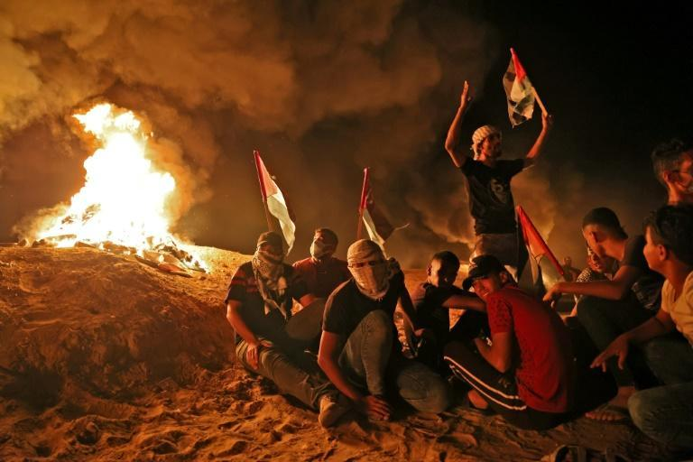 Palestinians gather during a recent night protest along the border fence in the southern Gaza Strip, demanding an end to Israel's blockade (AFP/SAID KHATIB)