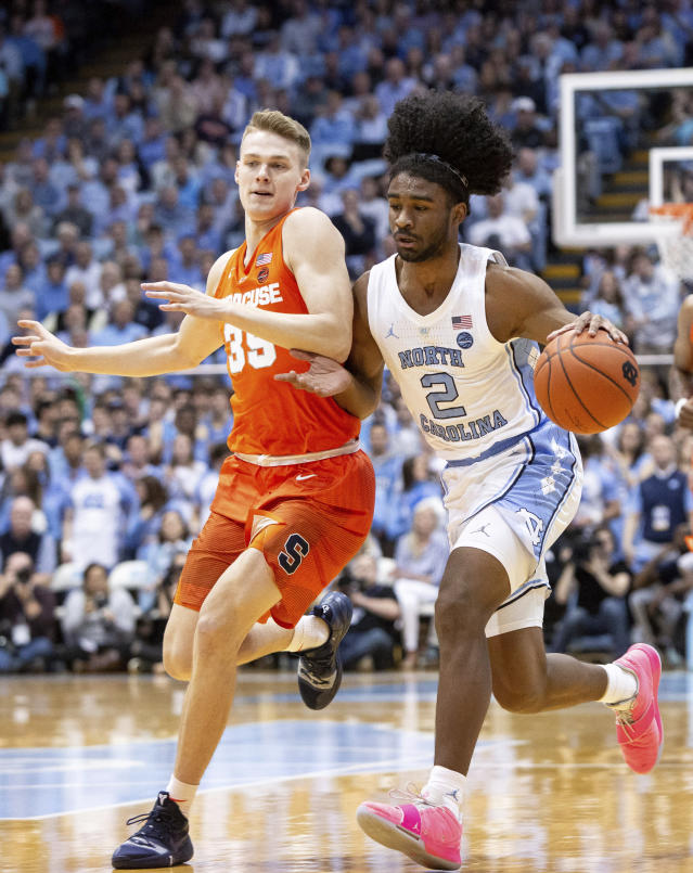 North Carolina's Colby White (2) handles the ball as Syracuse's Buddy Boeheim (35) defends during the first half of an NCAA college basketball game in Chapel Hill, N.C., Tuesday, Feb. 26, 2019. (AP Photo/Ben McKeown)