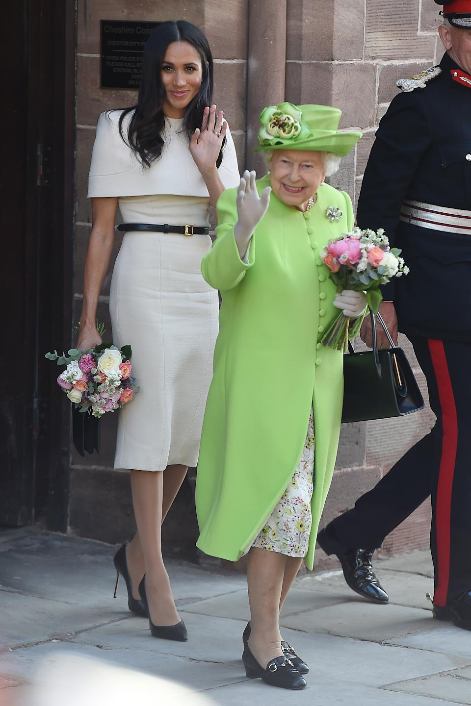 The Duchess of Sussex wore a sleek white dress for her first official appearance alongside Queen Elizabeth just one month after the royal wedding. It was made by her wedding dress designer, Clare Waight Keller. (Photo: Getty Images)